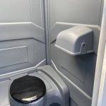 flushing toilet inside deluxe portable toilet
