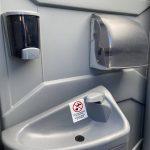 sink inside deluxe portable toilet