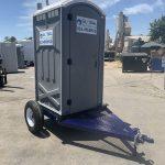 portable toilet trailer in yard