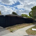 temp fence rental 2 with black privacy