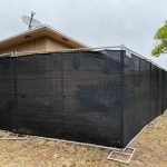temp fence rental 3 with black privacy